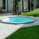 Oktagon Familypool - Liten pool - åttakantig pool - rund pool - med stenplattor runt om